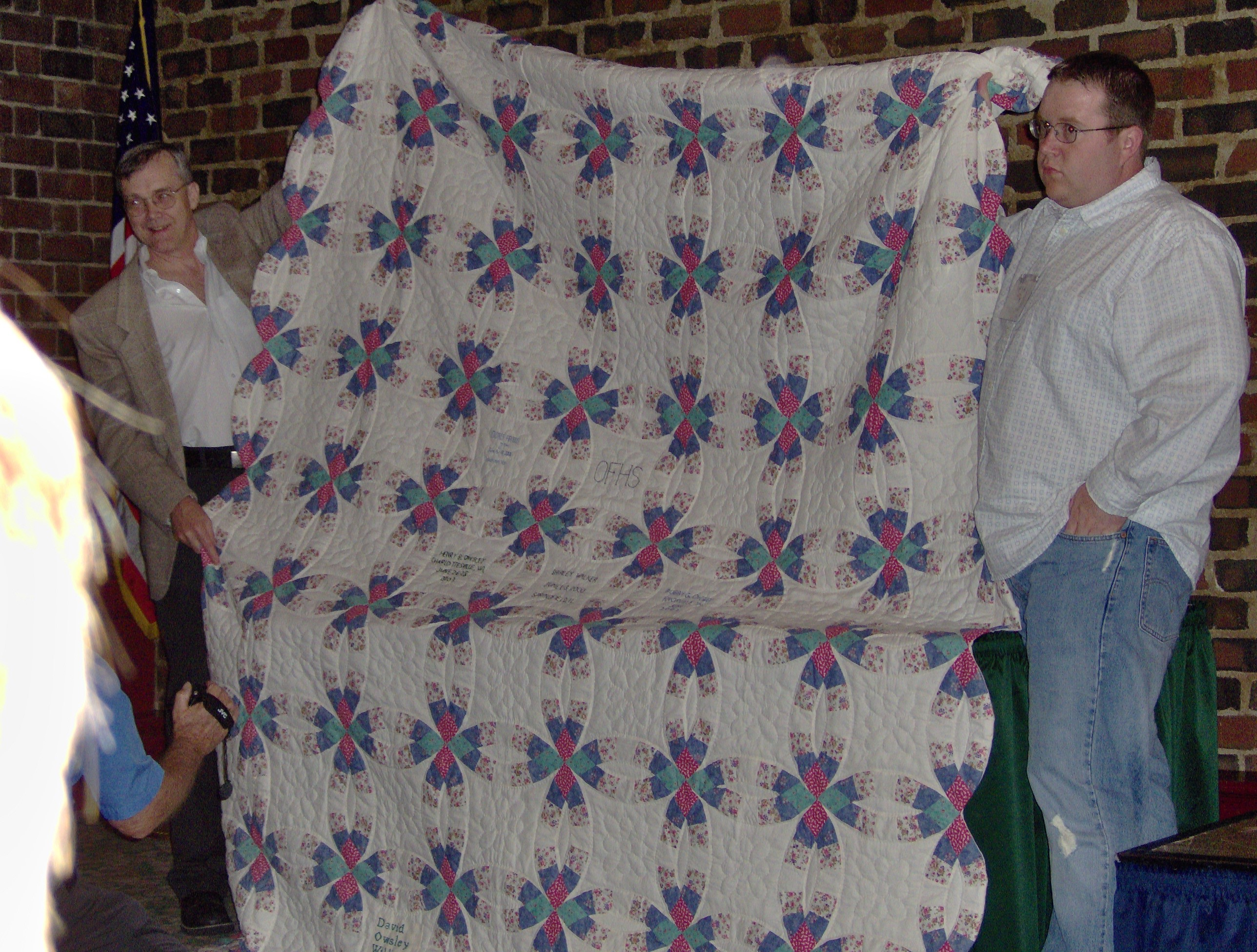 Gary Toms and Joseph Owsley showing the Owsley Quilt (2006 OFHS Meeting in Chattanooga